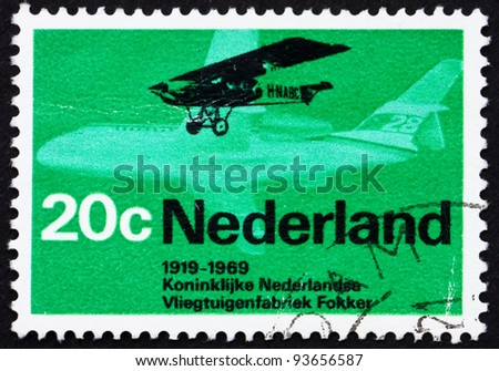 NETHERLANDS - CIRCA 1968: a stamp printed in the Netherlands shows Fokker F.2 from 1919 and Friendship F.29, circa 1968