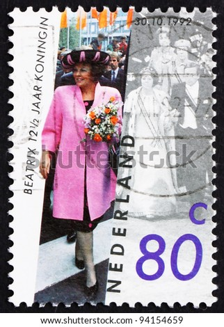 NETHERLANDS - CIRCA 1992: A stamp printed in the Netherlands shows Queen Beatrix, 12 Years since Investiture, circa 1992
