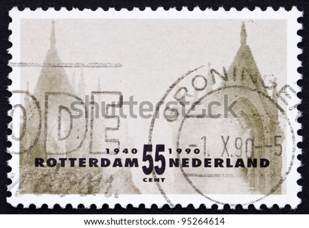 NETHERLANDS - CIRCA 1990: a stamp printed in the Netherlands shows Two Old Towers, Rotterdam Reconstruction after devastating bombardment in WWII, circa 1990