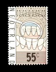 Netherlands - circa 1977 : Cancelled postage stamp printed by Netherlands, that shows teeth, circa 1977.
