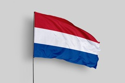 Netherlands flag isolated on white background with clipping path. close up waving flag of Netherlands. flag symbols of Netherlands. Netherlands flag frame with empty space for your text.