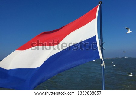 Netherlands flag on the Boat by Volendam, North Holland #1339838057