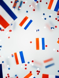 Netherlands King's birthday, liberation day. flags on a foggy background. The concept of freedom, patriotism and memory. National Unity and Solidarity Day. High quality photo