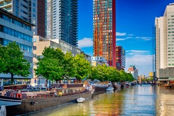 Netherlands Traveling. Attractive Cityscape of Rotterdam City with Canal and Boats in The Netherlands. Horizontal Image Composition