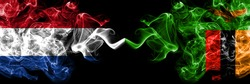 Netherlands vs Zambia, Zambian smoky mystic flags placed side by side. Thick colored silky abstract smoke flags.