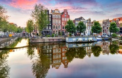 Netherlands with refleciotn in canal, Amsterdam at sunset