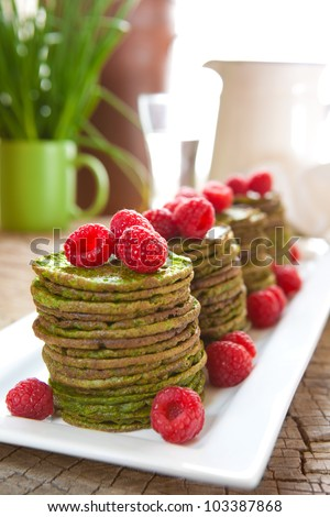 Nettle or spinach pancakes with raspberries
