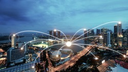 Network business conection system on Singapore smart city scape in background.Network business conection concept