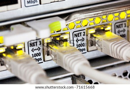 Network cables and hub. Closeup view with shallow DOF