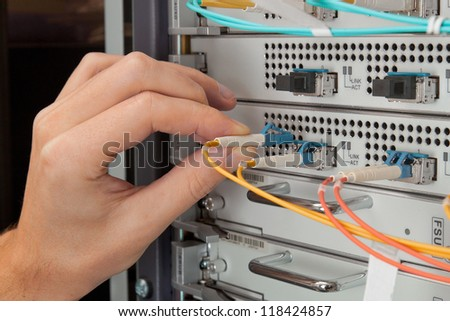 Network engineer insert patch cord
