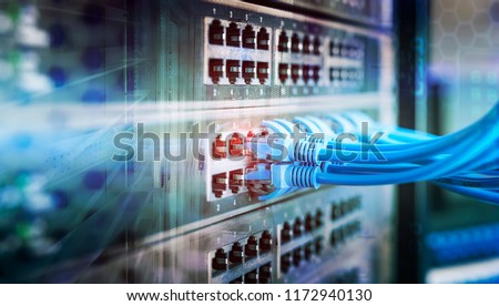 Network panel, switch and cable in data center Foto stock ©