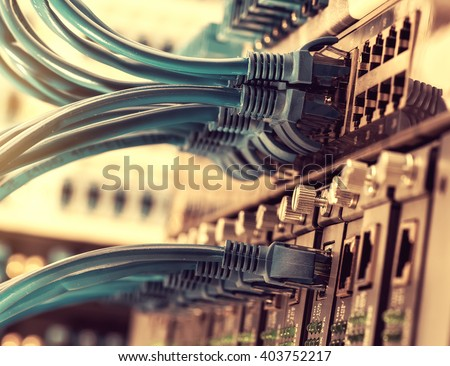 Network panel, switch and cable in data center Stock photo ©