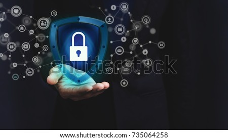 Network Security System Concept, Locked Key inside a Shield Guard to Protected Identify or Personal Information from Cyber Attacks, Present over Businessman Hand and Social Media icons