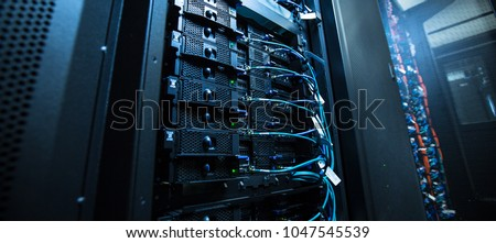 Network server room with servers/high performance computers running processes