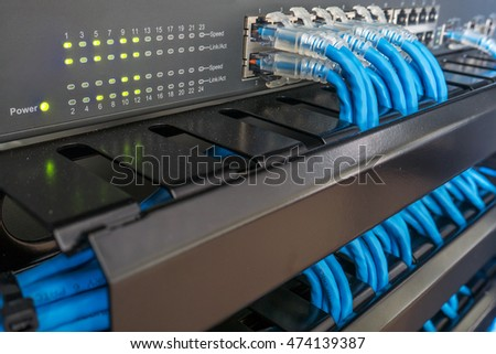 Network Switch And Ethernet Cables In Rack Cabinet #474139387