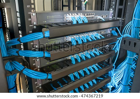 Network Switch And Ethernet Cables In Rack Cabinet #474367219