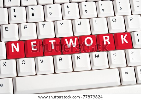 Network word on white keyboard - stock photo
