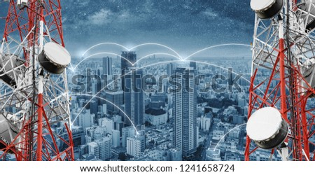 Networking and internet network technology in the city. Telecommunication towers with cityscape and networking lines