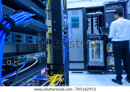 Networking device on rack cabinet and network administrator working in data center