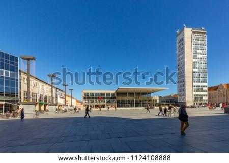 NEUBRANDENBURG, GERMANY - APR 1, 2016: central market place with socialistic art buildings in Neubrandenburg, Germany.