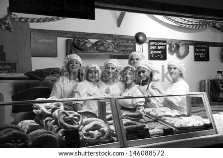 NEUBURG AN DER DONAU - JUNE 30:colleagues of bakery at  traditional German medieval festival on June 30, 2013 in Neuburg, Germany. This is annually festival in city Neuburg in Bavaria, Germany