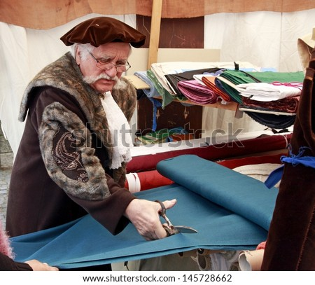 NEUBURG AN DER DONAU - JUNE 30:tailor in traditional German medieval costum at the festival on June 30, 2013 in Neuburg, Germany. This is annually festival in Neuburg in Bavaria, Germany