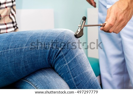 neurologist checks reflexes hammering knee. The doctor examines the patient's knee.
