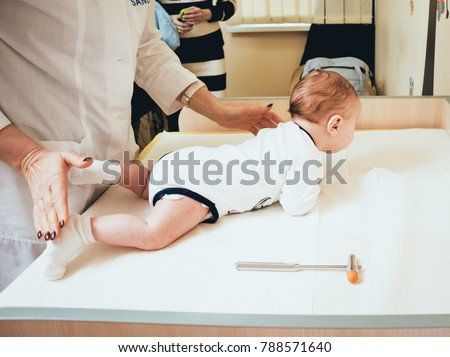 Neurologist diagnosing little boy. Pediatric examination