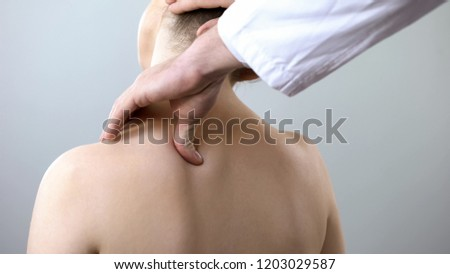 Neurologist examining female neck, examining head and shoulder, healthcare