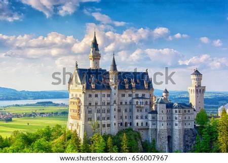 Neuschwanstein castle in Bavarian alps, Germany. Famous landmark #656007967