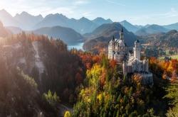 Neuschwanstein Castle under Sunlight with Mountain Hills on Background, Amazing Landscape Scenery. Picture of the fairy tale Castle near Munich in Bavaria, Fussen, southwest Bavaria, Germany