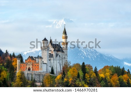 Neuschwanstein, summer sunrise landscape panorama picture of the fairy tale castle near Munich in Bavaria, Germany.