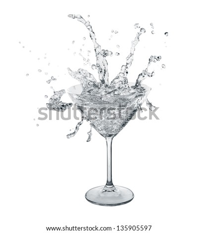 Neutral color water slashes in martini glass. Isolated on white.