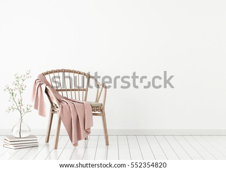 Shutterstock Neutral interior mockup with wicker chair, plaid and plant in vase on empty wall background. 3D rendering.