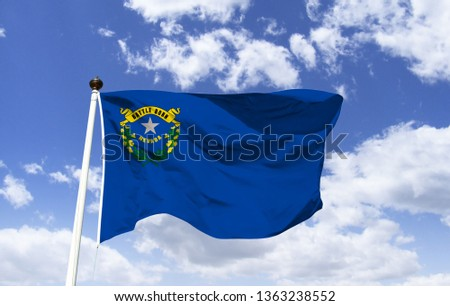 Nevada flag mockup in the wind. The symbol of Nevada. The flag of Nevada as a symbol. Flag of the State of Nevada. Flag of the USA state.