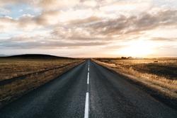 Never ending road till horizon on a sunrise sunset
