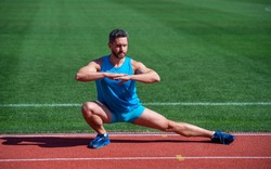 Never give up. sport success. male athlete do morning exercise. warm up workout. sportsman flex muscles outdoor. muscular guy do stretching. man in yoga pose. sports and healthy lifestyle routine.