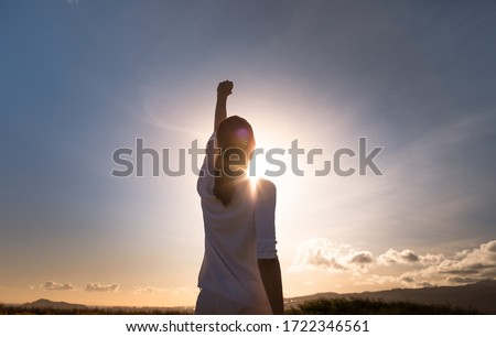 Never give up. Woman with fist up feeling strong, powerful and determined.  Сток-фото ©