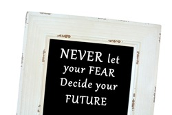 Never let your fear decide your future words on chalk board close up