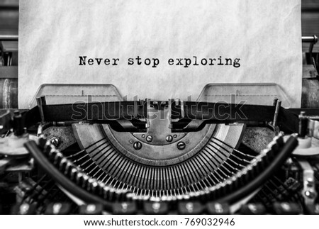 never stop exploring printed on an old typewriter, vintage. close-up. Motivation for success #769032946
