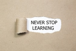 NEVER STOP LEARNING message written under torn paper.