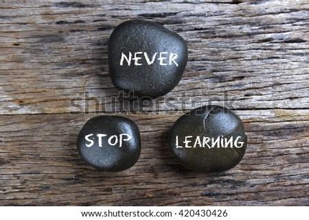 Never stop learning, three words motivational slogan conceptual  #420430426