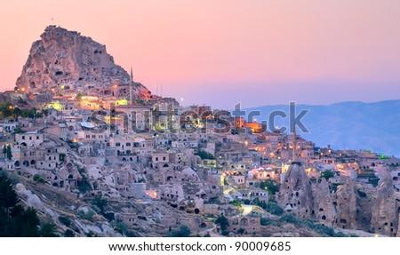 Nevsehir cave city in Cappadocia, Turkey on sunset