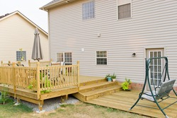 New above ground deck and patio of family home.
