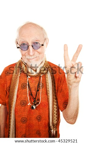 New age senior man in orange shirt making peace sign