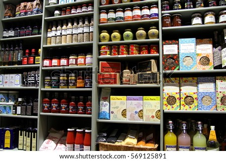 New Alresford, UK - Jan 28 2017: Selection of herbs, spices, pickles, sauces, spreads, preserves, relishes, pasta and other exotic ingredients in an organic wholefood shop #569125891