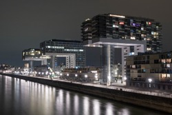 New and modern Kranhaus buildings in Cologne/Germany. Rhine river. Night. Long exposure.