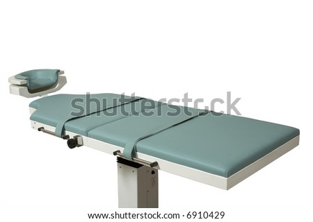 New and modern surgical table on a white background