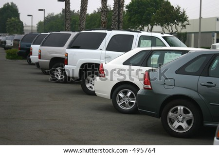 new and used cars at a dealership.