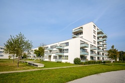New apartment building - modern residential development in a green urban settlement